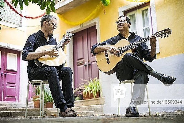 Two fado guitarists with acoustic and portuguese guitars in Alfama  Lisbon  Portugal  Europe