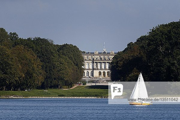 Sailing boat passing the Schloss Herrenchiemsee Castle  Chiemgau  Upper Bavaria  Germany  Europe