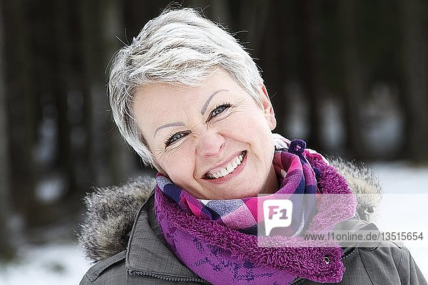 Portrait of a woman in a winter forest  Oberhof  Thuringia  Germany  Europe