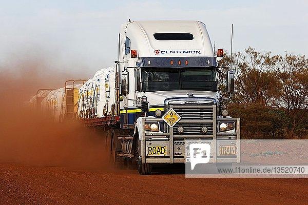 Freightliner road train truck on dusty red outback Australian road  Pilbara  Western Australia  Australia  Oceania