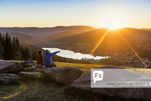Older couple at Hochfirst with view to Titisee and Feldberg at sunset  near Neustadt  Black Forest  Baden-Württemberg  Germany  Europe