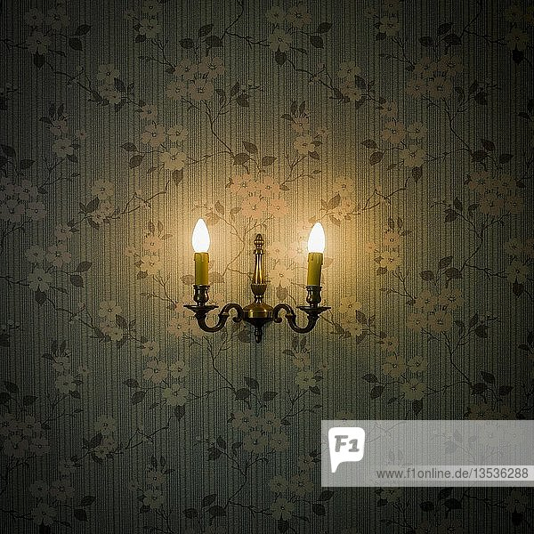 Old fashioned light on floral wallpaper  France  Europe