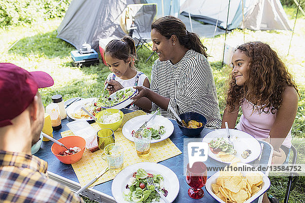 Family enjoying lunch at campsite table