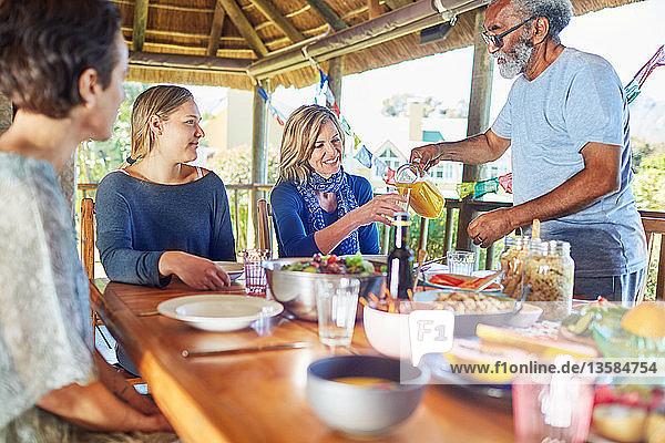 Friends enjoying healthy breakfast in hut during yoga retreat