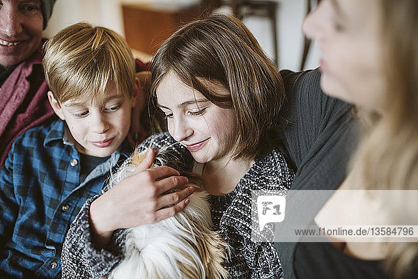 Affectionate family with guinea pig