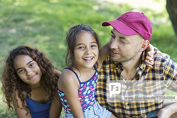 Portrait happy father and daughters