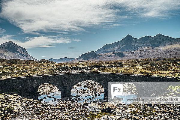 Bridge over remote craggy river,  Isle of Skye,  Scotland