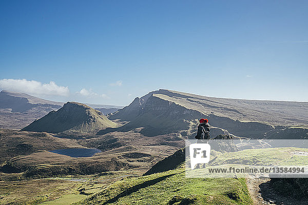 Female hiker looking at sunny landscape view  Isle of Skye  Scotland