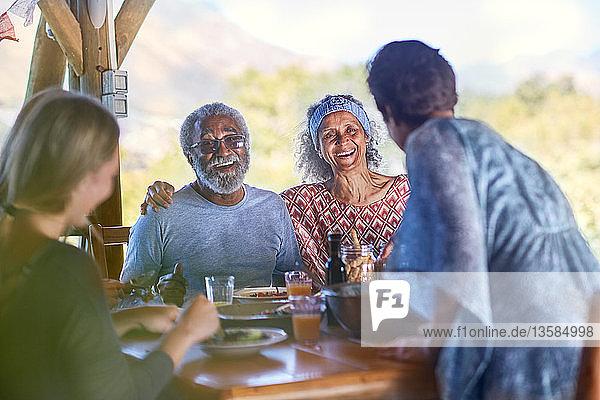 Happy senior couple enjoying breakfast on yoga retreat