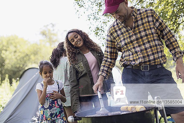Family barbecuing at campsite