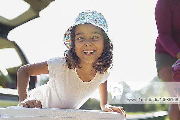 Portrait confident  happy girl in sun hat