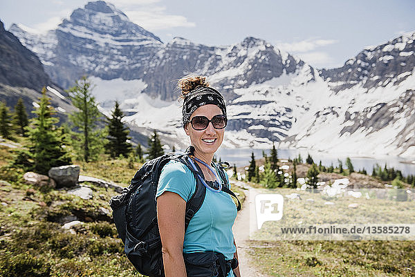 Portrait confident female hiker on sunny  idyllic mountain trail  Yoho Park  British Columbia  Canada