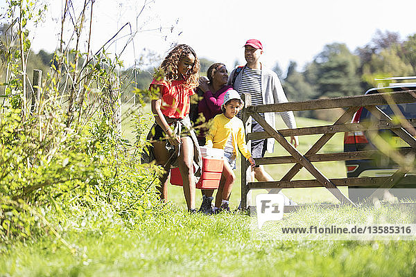 Family camping  walking in sunny field