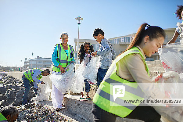 Volunteers cleaning up litter on sunny beach