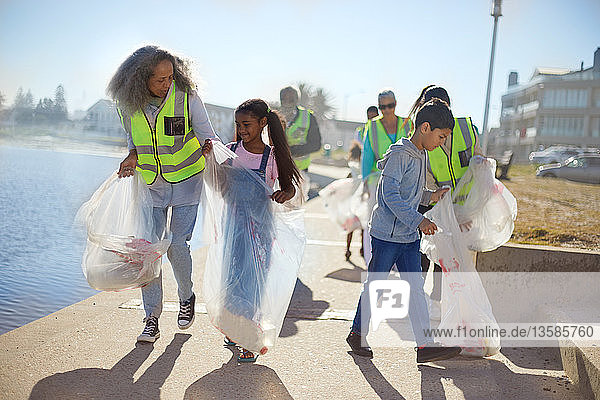 Volunteers cleaning up litter on sunny boardwalk
