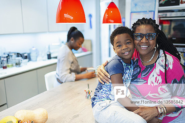 Portrait affectionate grandmother and grandson in kitchen