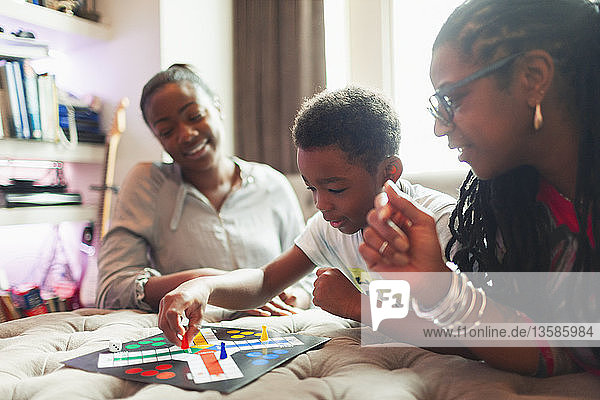 Multi-generation family playing board game