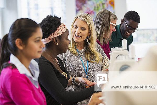 Fashion designers talking  working at sewing machines