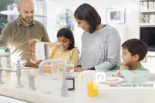 Family enjoying breakfast in kitchen