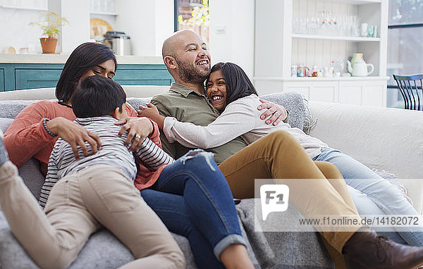 Happy  affectionate family on living room sofa