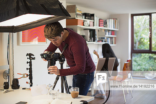 Male photographer working in studio