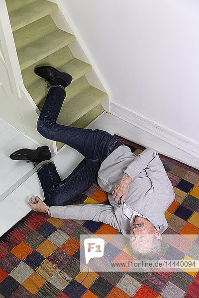 Elderly man who has fallen down stairs.