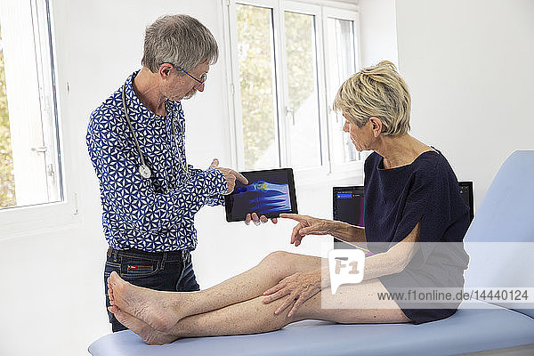 Woman consulting a doctor for a pain in her toe.
