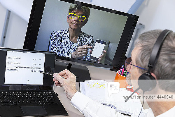 Video consultation between a doctor and patient who wishes to have her medical tests explained.