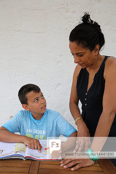 11-year-old boy helped with his homework by his mother in Salento  Italy