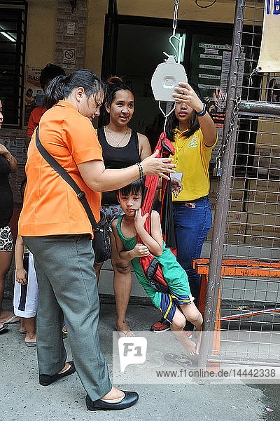 Child's weighing in a health center in Manila  in the Philippines.