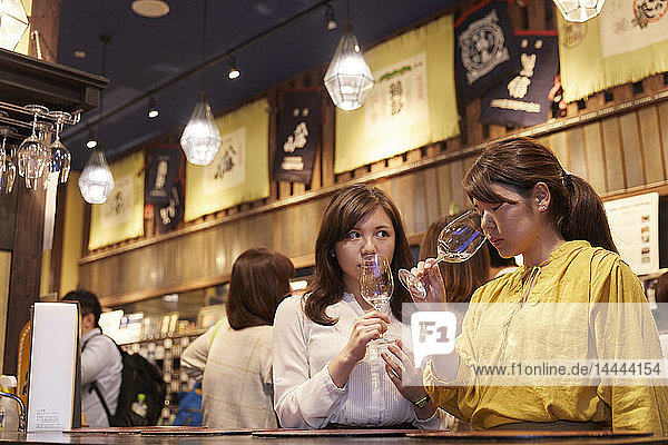 Japanese women enjoying sake tasting