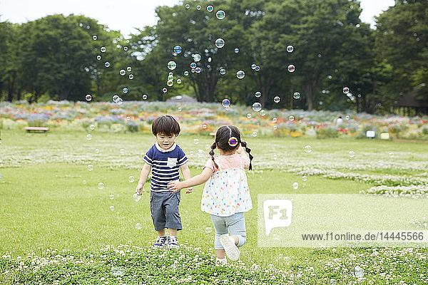 Japanese kids at a city park