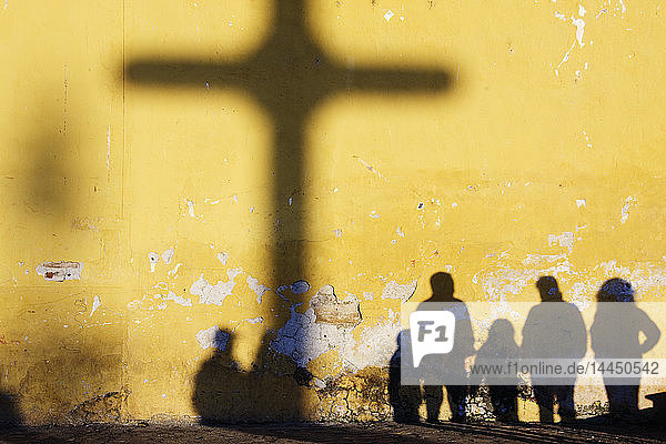 Shadow of Cross and People