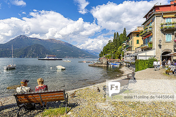 View of visitors on the lakeside in Vezio  Province of Como  Lake Como  Lombardy  Italian Lakes  Italy