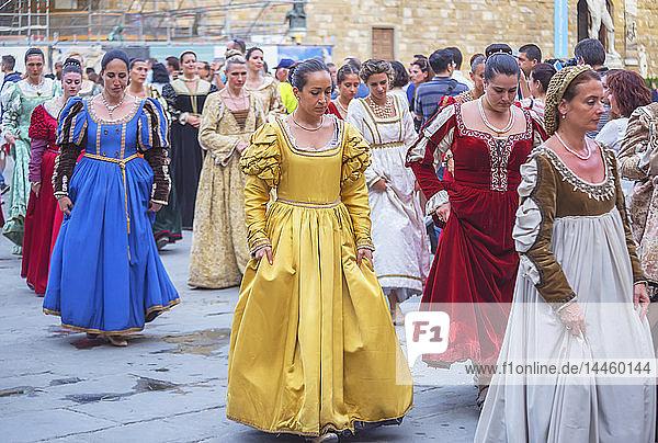 Women marching in costume dresses during Calcio Storico Fiorentino festival at Piazza della Signoria in Florence  Tuscany  Italy
