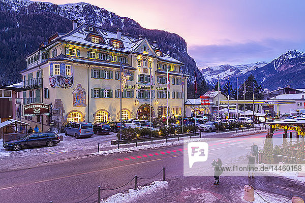 View of Hotel Dolomiti Canazei at dusk in winter  Canazei  Val di Fassa  Trentino  Italy