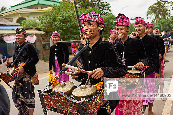 Musicians leading a traditional Sasak wedding procession  Lombok  Indonesia  Southeast Asia