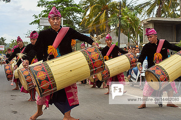 Drummers leading a traditional Sasak wedding procession  Lombok  Indonesia  Southeast Asia