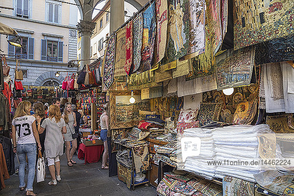 Customers shopping at Mercato Nuovo in Florence  Tuscany  Italy
