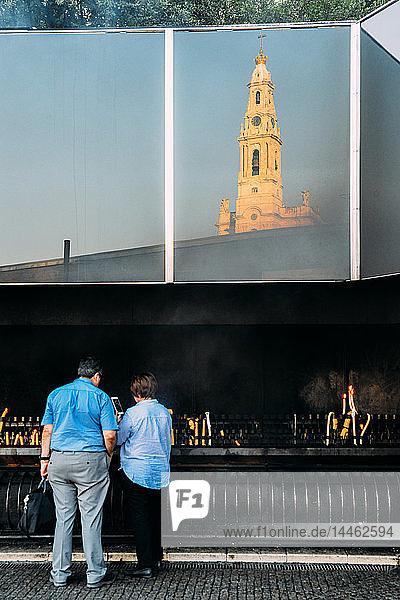 Religious pilgrims light candles at Sanctuary of Fatima (Basilica of Our Lady of Fatima)  Portugal