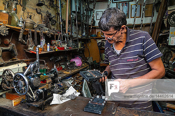 Man in his mechanical repair shop in an alleyway in the Old City (Medina) of Fez  UNESCO World Heritage Site  Morocco  North Africa