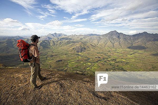 Climber looks across the Tsaranoro Massif  southern Madagascar