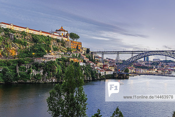View of Monastery of Saint Augustine of Serra do Pilar and Dom Luis Bridge over the Douro River in the evening  Porto  Portugal