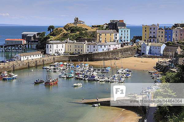 Harbour Beach  boats  colourful historic buildings  Castle Hill  lifeboat station on a sunny day  Tenby  Pembrokeshire  Wales  Europe