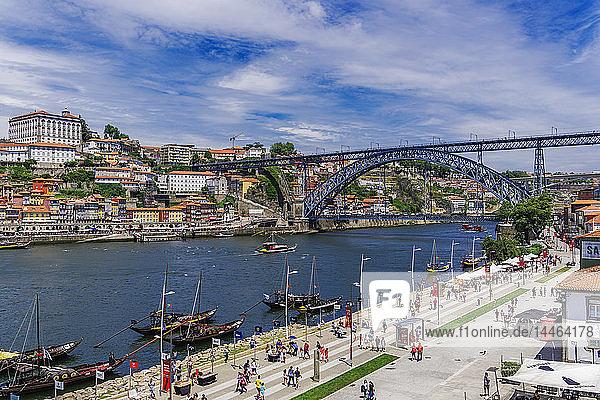 View of Dom Luis I Bridge over Douro River and Vila Nova de Gaia waterfront with Porto wine ships and Ribeira view  Porto  Portugal