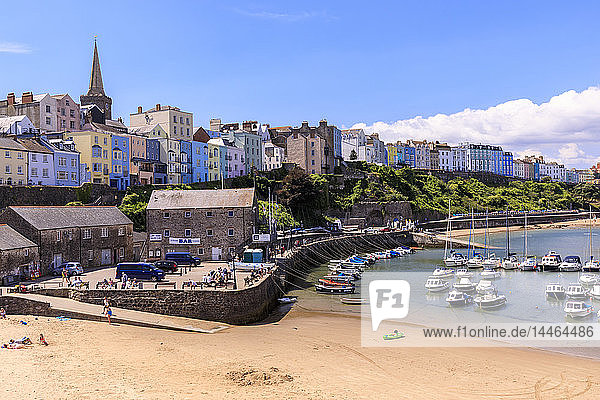 Colourful historic town and St. Mary's church  from Harbour Beach  boats on a sunny day  Tenby  Pembrokeshire  Wales  United Kingdom  Europe