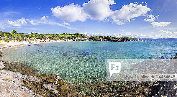 Girl in swimsuit looks at the beach  La Bobba Beach  San Pietro Island  Sud Sardegna province  Sardinia  Italy  Mediterranean