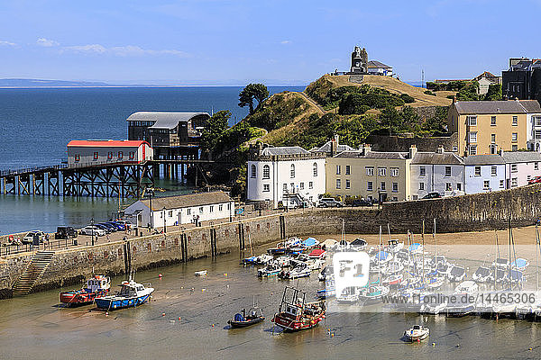 Harbour Beach  boats  colourful historic buildings  Castle Hill  lifeboat station on a hot sunny day  Tenby  Pembrokeshire  Wales  United Kingdom  Europe