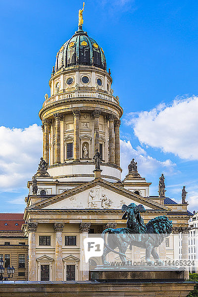 Statue in front of French Cathedral on Gendarmenmarkt square  Berlin  Germany