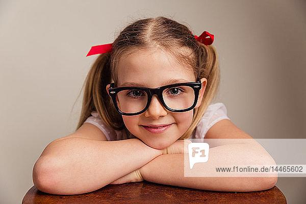 Portrait of smiling ittle girl wearing oversized glasses
